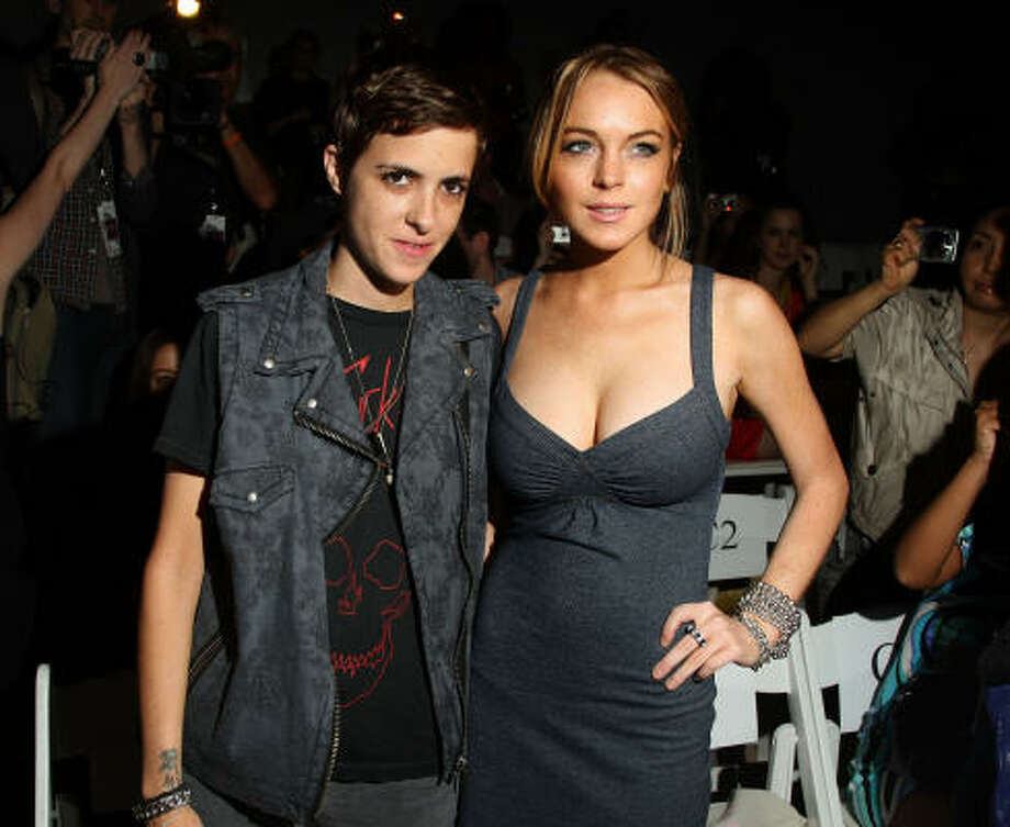 The romance between DJ Samantha Ronson and actress Lindsay Lohan has been rife with struggle: from odd Twitter messages to late-night fights outside drinking establishments. Split for good since 2009, Lohan now admits she hopes they get back together. Photo: Stephen Lovekin, Getty Images For IMG