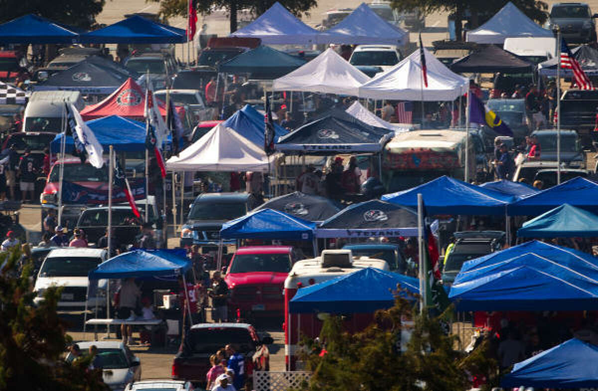 Football fans tailgate in the South Kirby Lot before an NFL football game between the Houston Texans and New York Giants at Reliant Stadium Sunday.