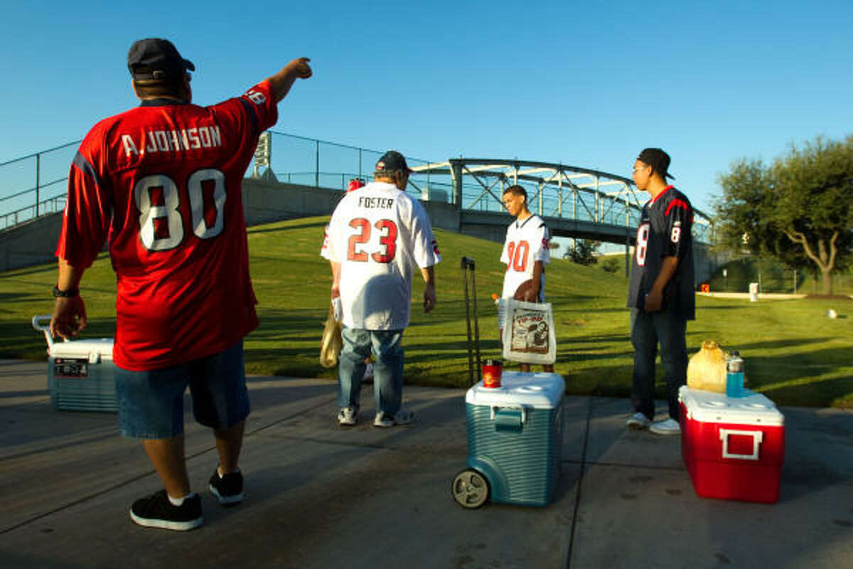 Houston Texans fans line up while waiting for the pedestrian tailgating gates to open before an NFL football game between the Texans and New York Giants at Reliant Stadium Sunday.