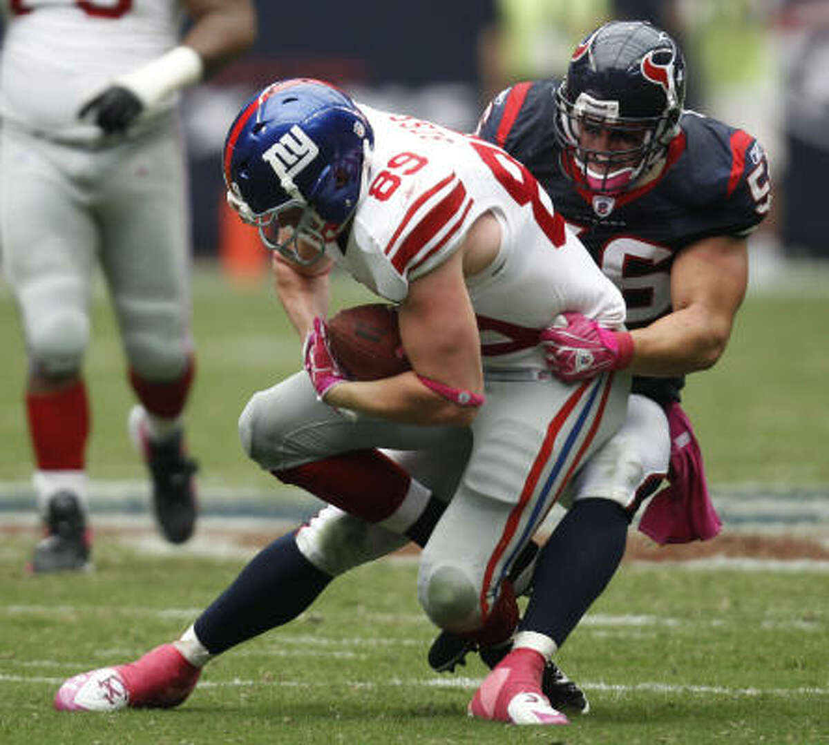 Oct. 10: Giants 34, Texans 10 Giants tight end Kevin Boss (89) is tackled by Texans linebacker Brian Cushing. In his return after the four-game suspension, Cushing had nine tackles, four of which were solo stops.