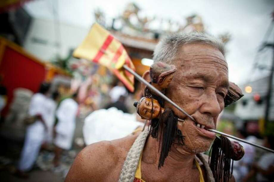 This devotee uses more decorative skewers. Photo: Athit Perawongmetha, Getty Images