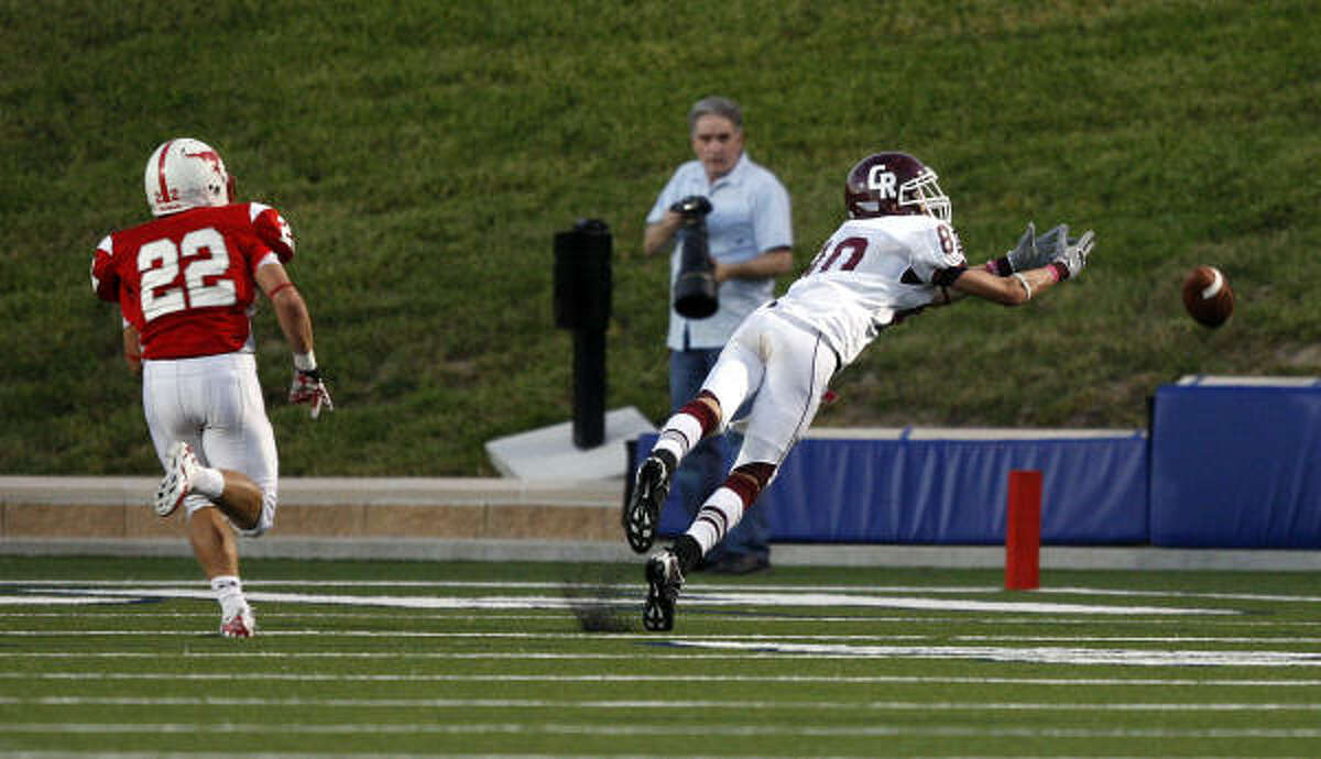 Cinco Ranch wide receiver Bobby Waid dives but can't come up with the pass after getting behind Memorial's Brett Strake.