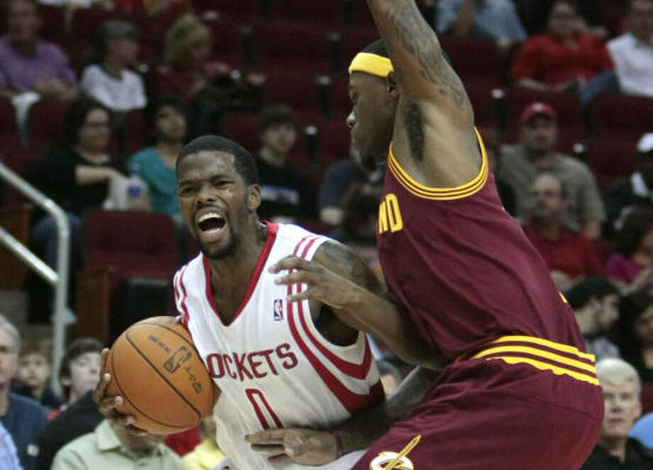 Rockets guard Aaron Brooks scored nine points in Sunday's loss at Toyota Center. Photo: Billy Smith II, Chronicle