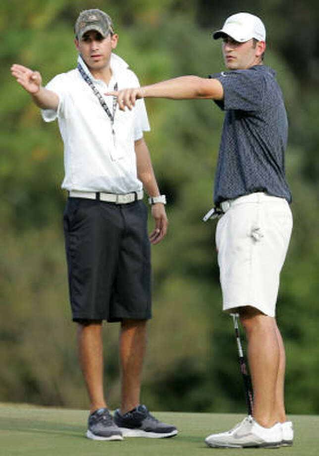 Justin Kaplan, right, and caddie A.J. Ferries go over the 13th green. Photo: ERIC CHRISTIAN SMITH, For The Chronicle.