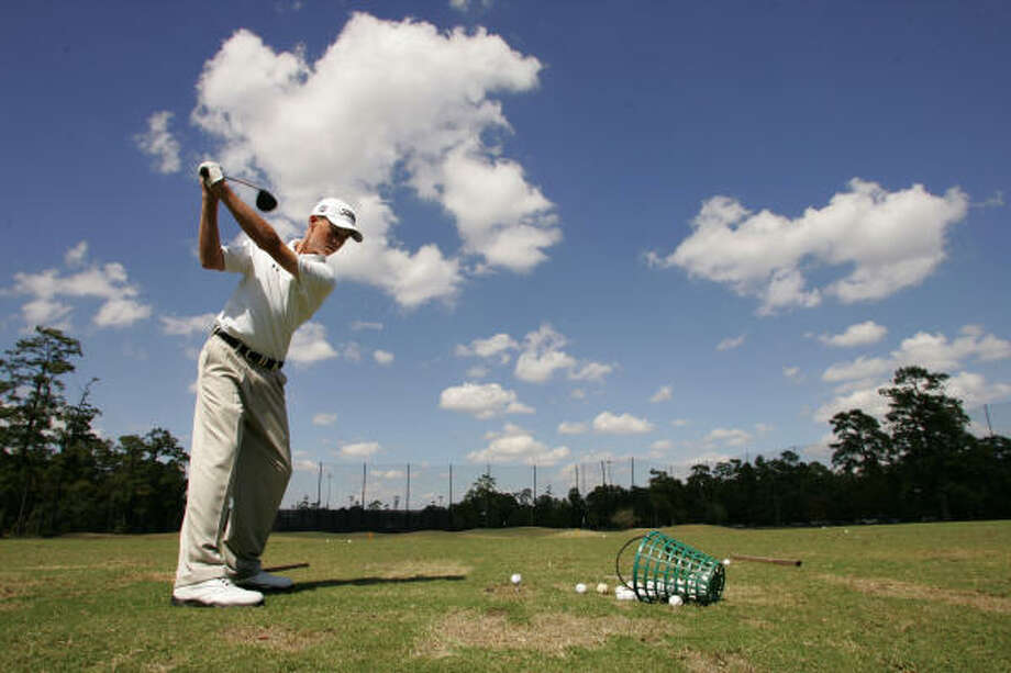 Connor Black warms up on the practice range before the final round. Photo: ERIC CHRISTIAN SMITH, For The Chronicle