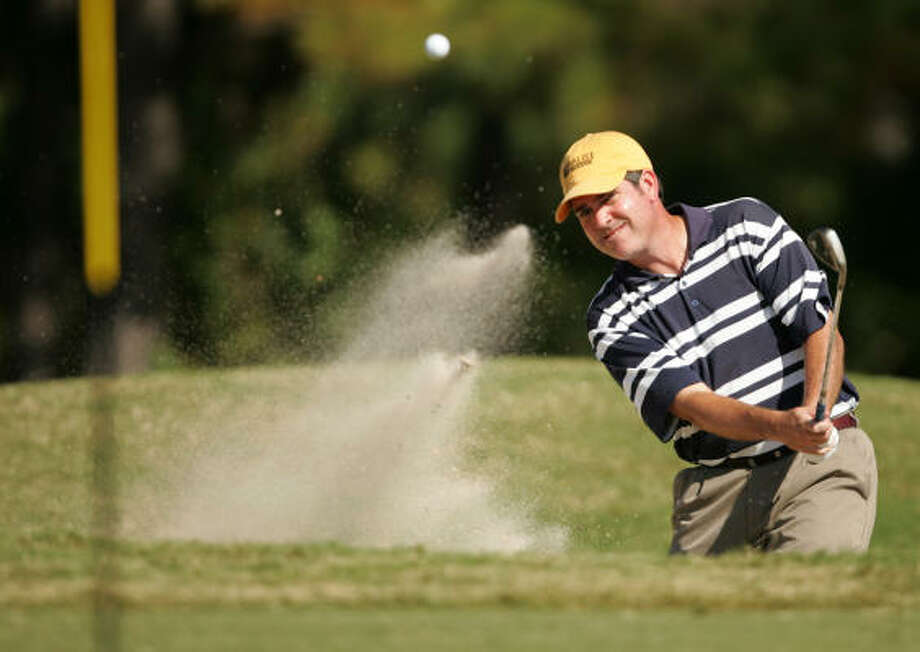 Jed Shreve blasts out of a greenside bunker on No. 17. Photo: ERIC CHRISTIAN SMITH, For The Chronicle