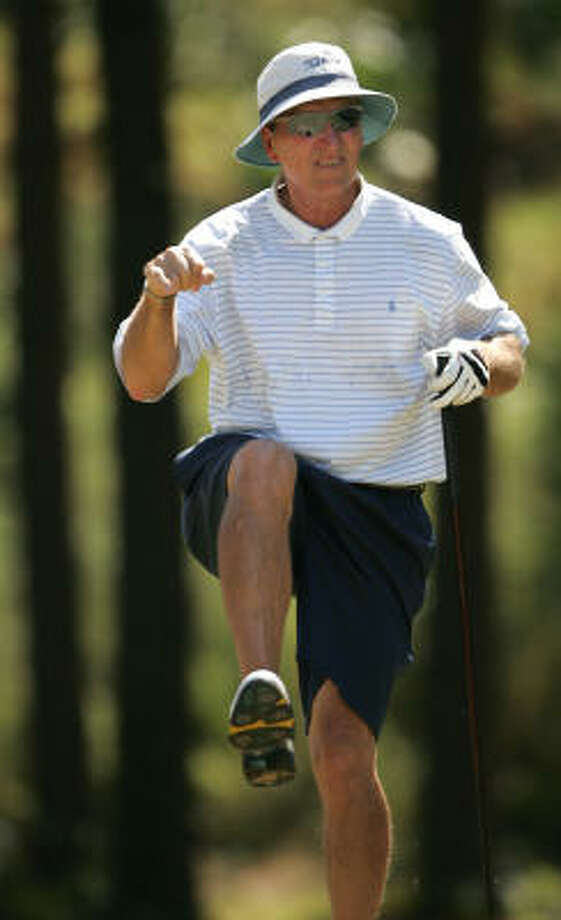 Bob Smith adds some body English to his tee shot on No. 11. Photo: ERIC CHRISTIAN SMITH, For The Chronicle