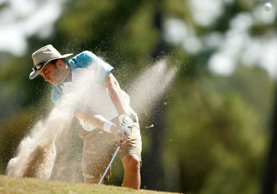 Paul Berman blasts out of a fairway bunker on No. 10. Photo: ERIC CHRISTIAN SMITH, For The Chronicle