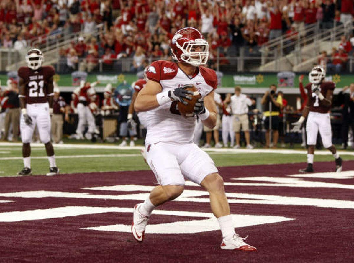 No. 11 Arkansas 24, Texas A&M 17 Arkansas tight end Ben Cleveland scores a second-quarter touchdown.