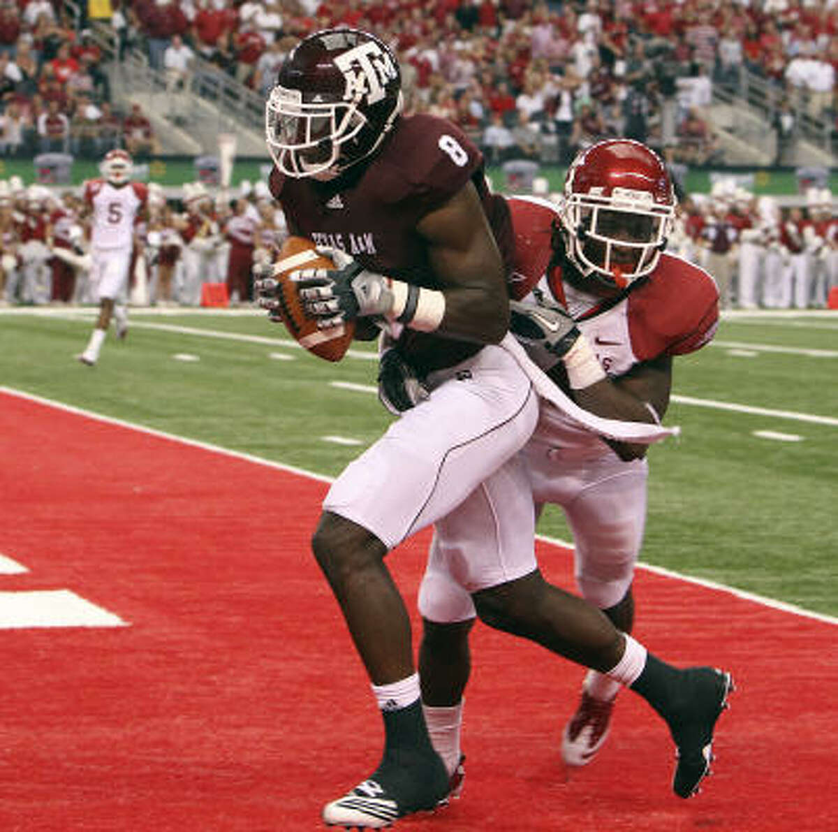 Texas A&M wide receiver Jeff Fuller snags a pass for touchdown in the closing seconds of the first half.