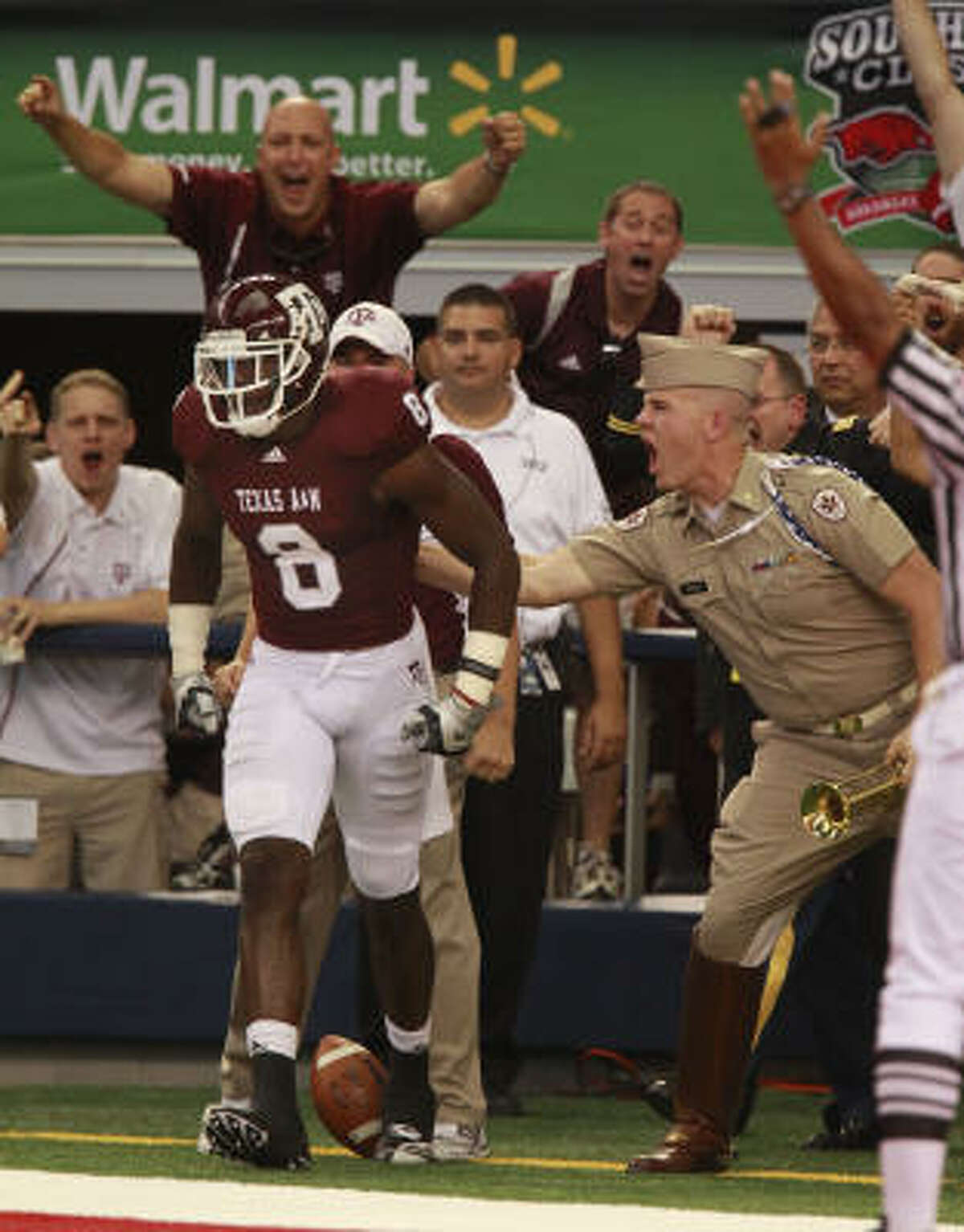 Texas A&M wide receiver Jeff Fuller celebrates his touchdown reception against Arkansas.