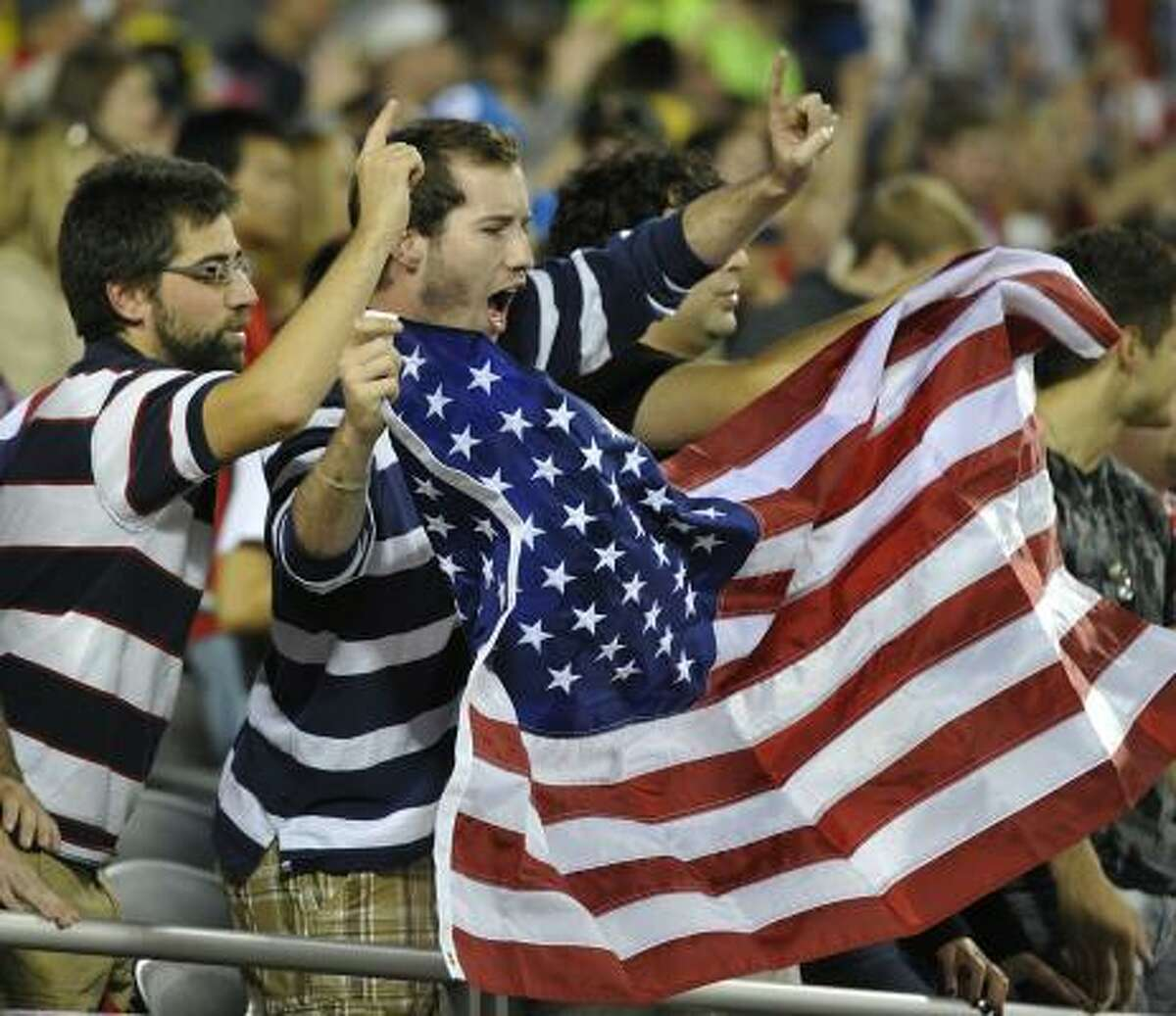 Fans of the USA soccer team cheer the players on during a friendly match against Poland.