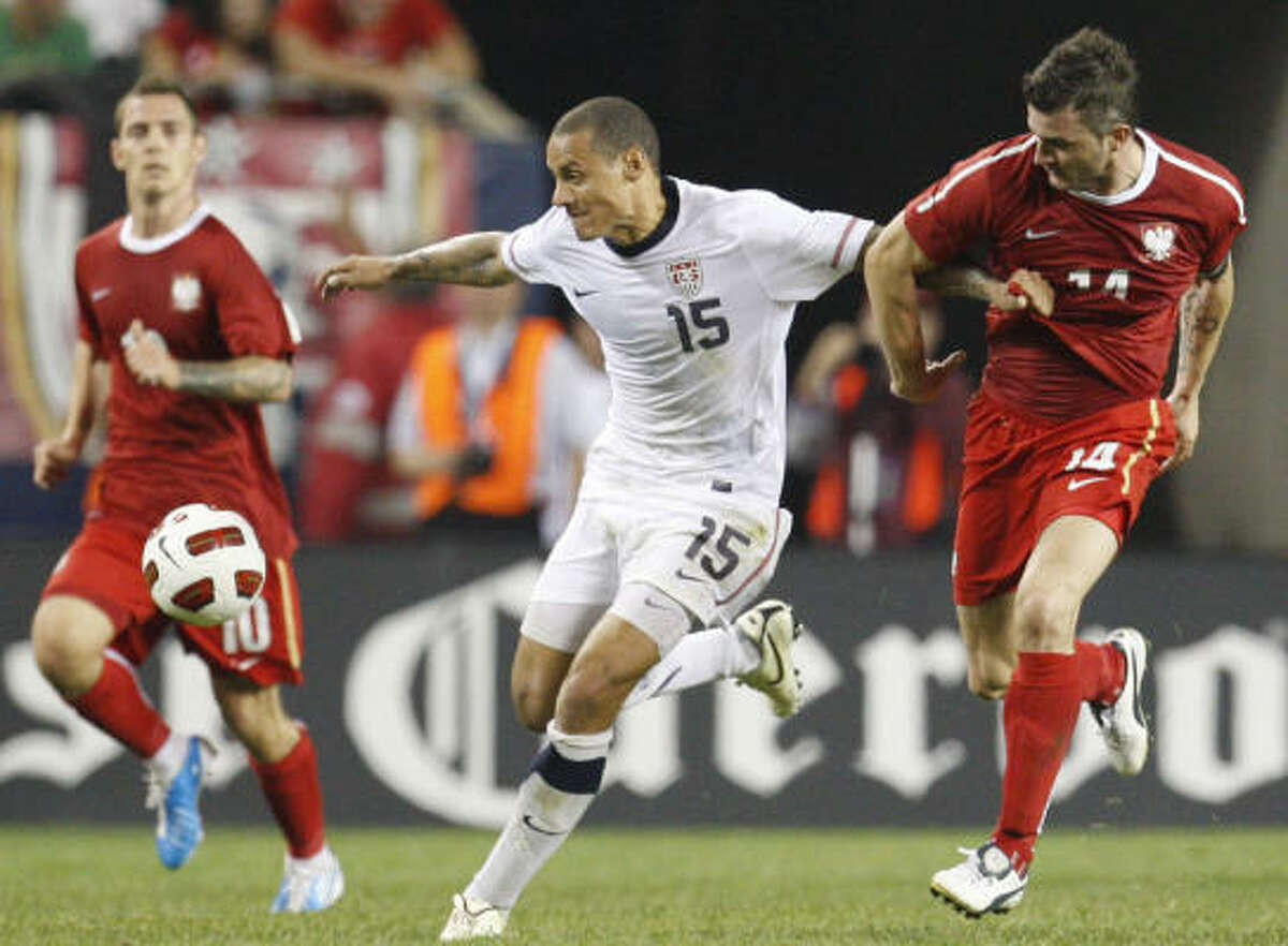 Team USA midfielder Jermaine Jones battles for the ball with Poland defender Michal Zewlakow.