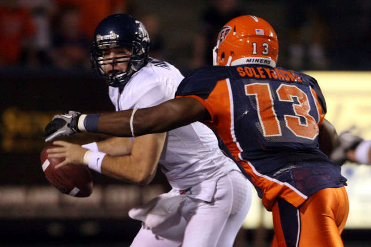 Rice quarterback Nick Fanuzzi tried to elude UTEP defensive lineman Robert Soleyjacks after he recovered a wild snap in the UTEP endzone.