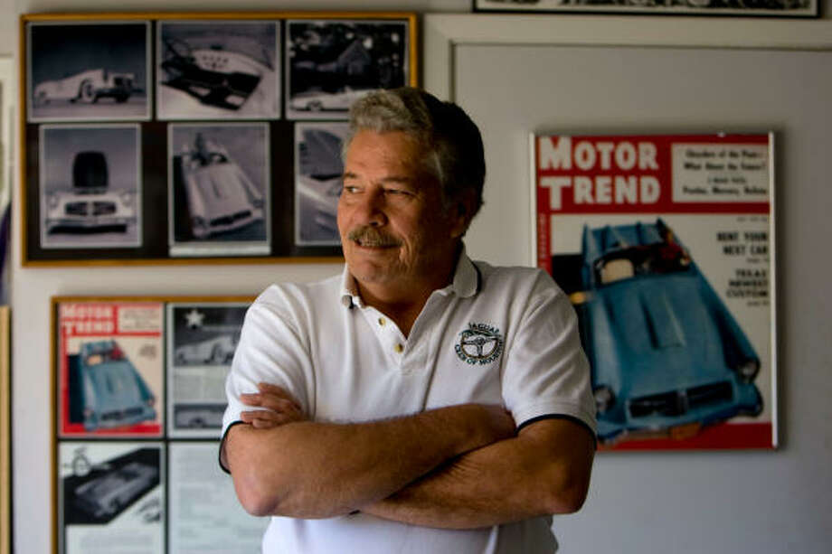 Patrick McLoad, stands next to a Motor Trend magazine from 1954 in his garage that featured the 1954 Venus that his father, Ken McLoad, designed and built in Houston. Photo: Johnny Hanson, Chronicle