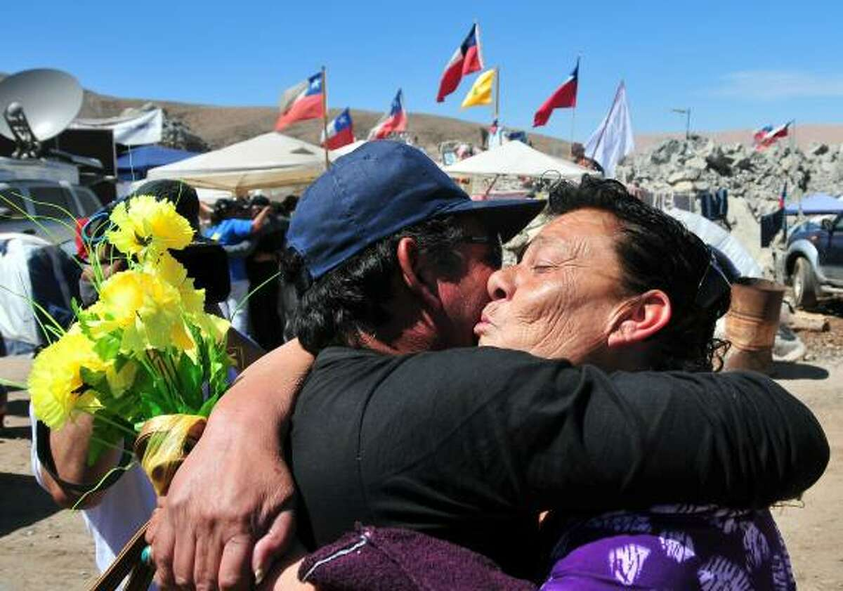 Relatives of the trapped miners celebrate after one of the drills working to rescue the 33 finally reached their shelter in the San Jose mine, near Copiapo, Chile. After a record two months trapped underground in a collapsed mine, the miners appear to be just days from a miraculous rescue.
