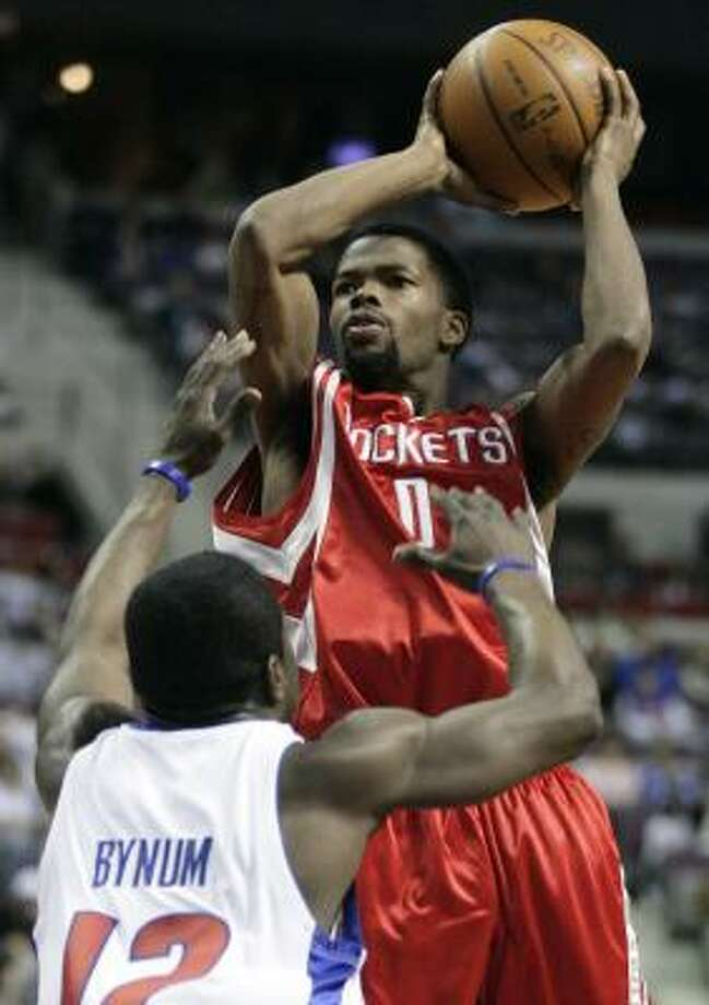 Aaron Brooks shoots over Pistons guard Will Bynum. Photo: Duane Burleson, AP