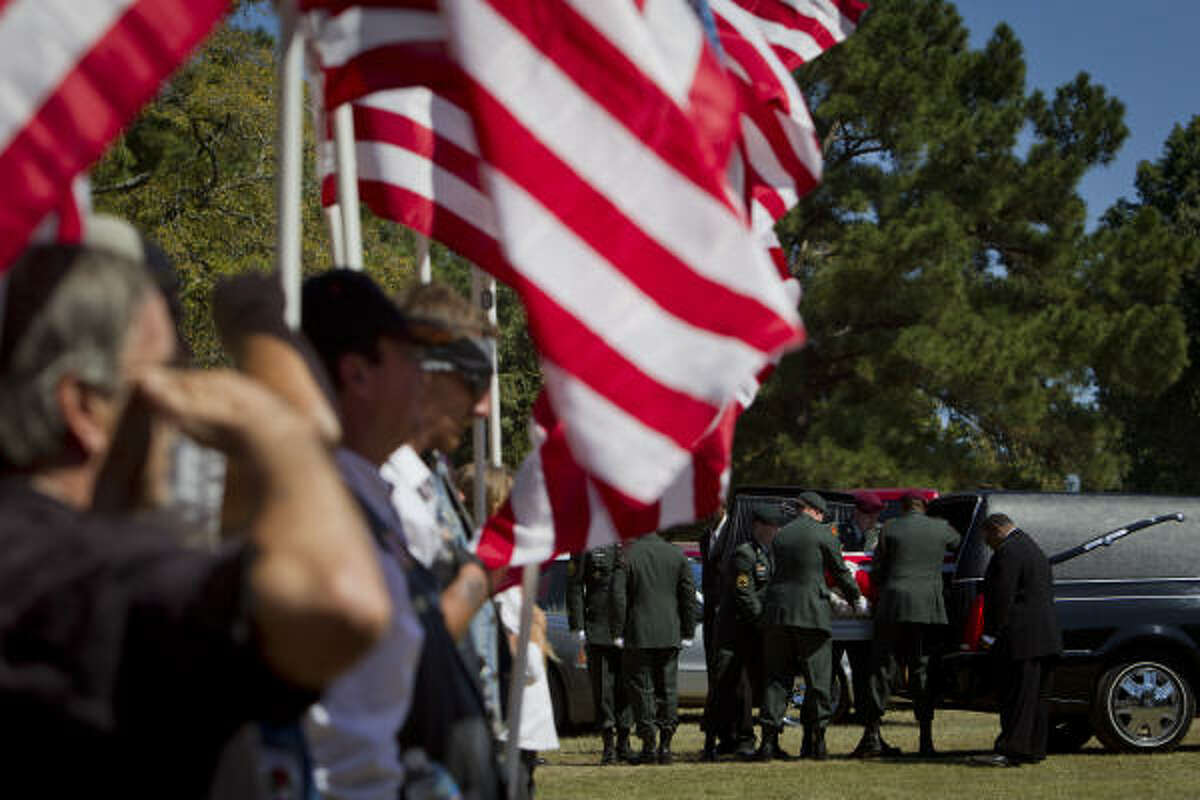 The casket of Sgt. 1st Class Calvin B. Harrison, who died in Afghanistan, is carried to the cemetery after the funeral services.
