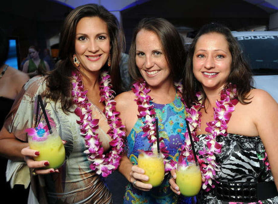 "From left: Jessica Gumm, Amanda Burnett and Tracy Eads Posesta at the ""Blue Hawaii"" Houston Police Foundation 2010 Gala at the home of Paige and Tilman Fertitta. Photo: Dave Rossman, For The Chronicle"