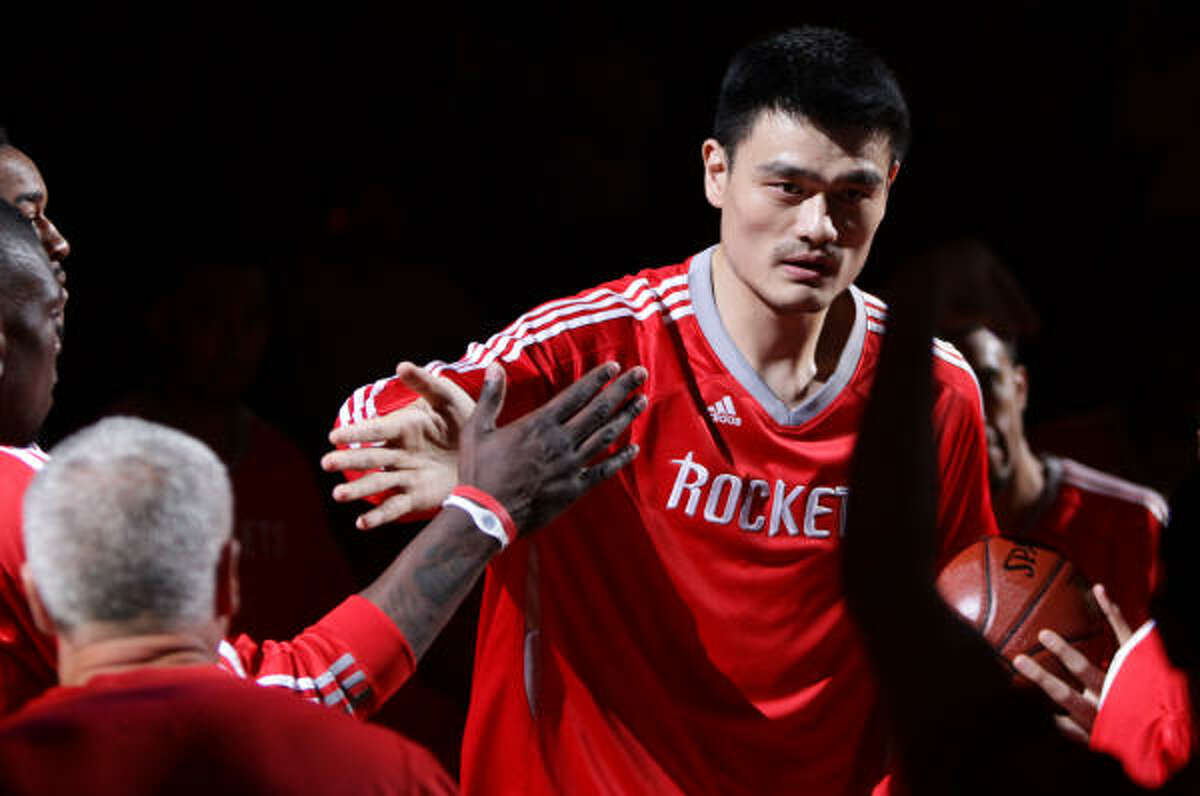 Rockets center Yao Ming walks onto the court during pregame introductions.