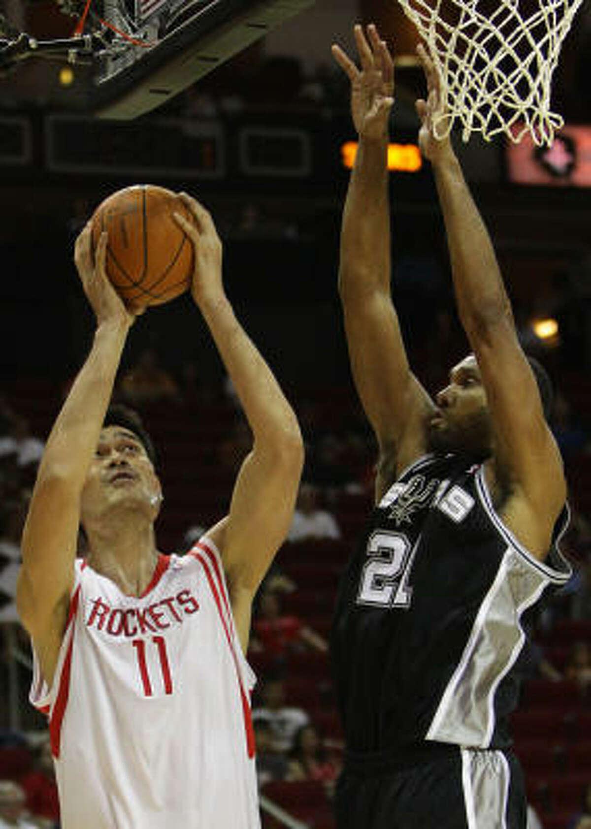 Rockets center Yao Ming hoists a shot over Spurs center Tim Duncan.