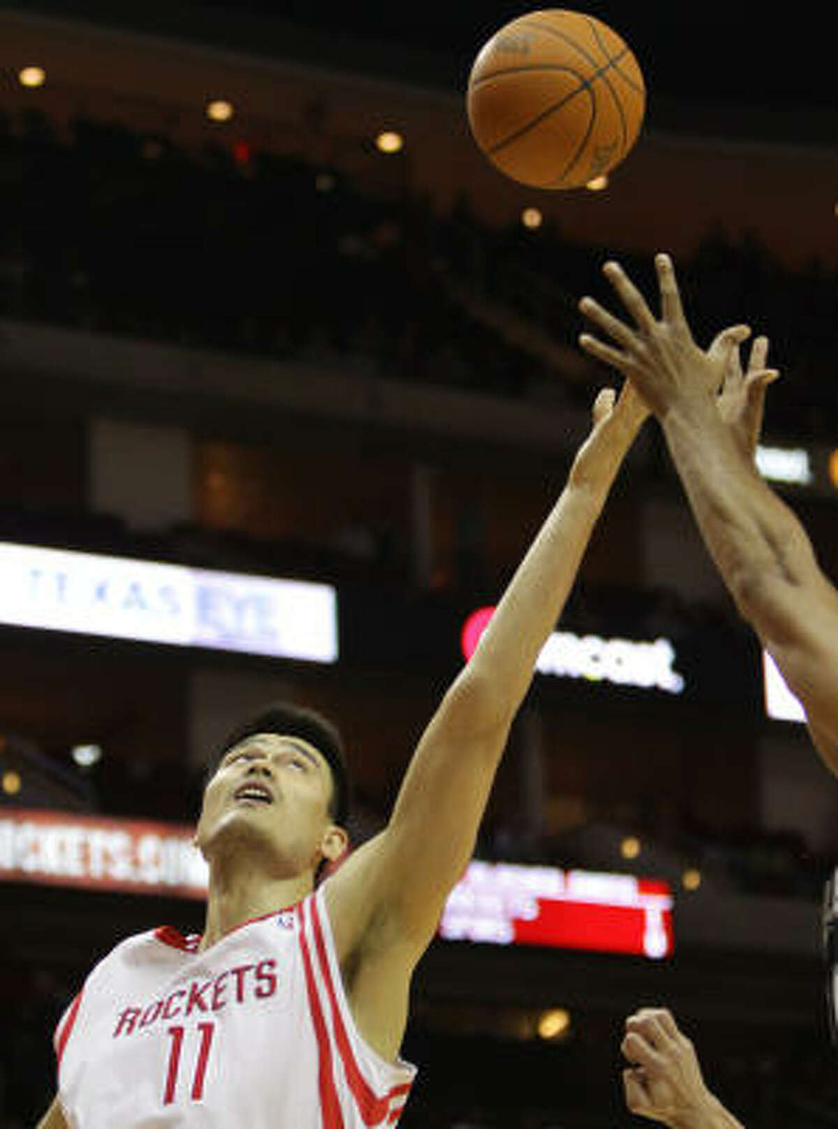 Rockets center Yao Ming stretches for a rebound.