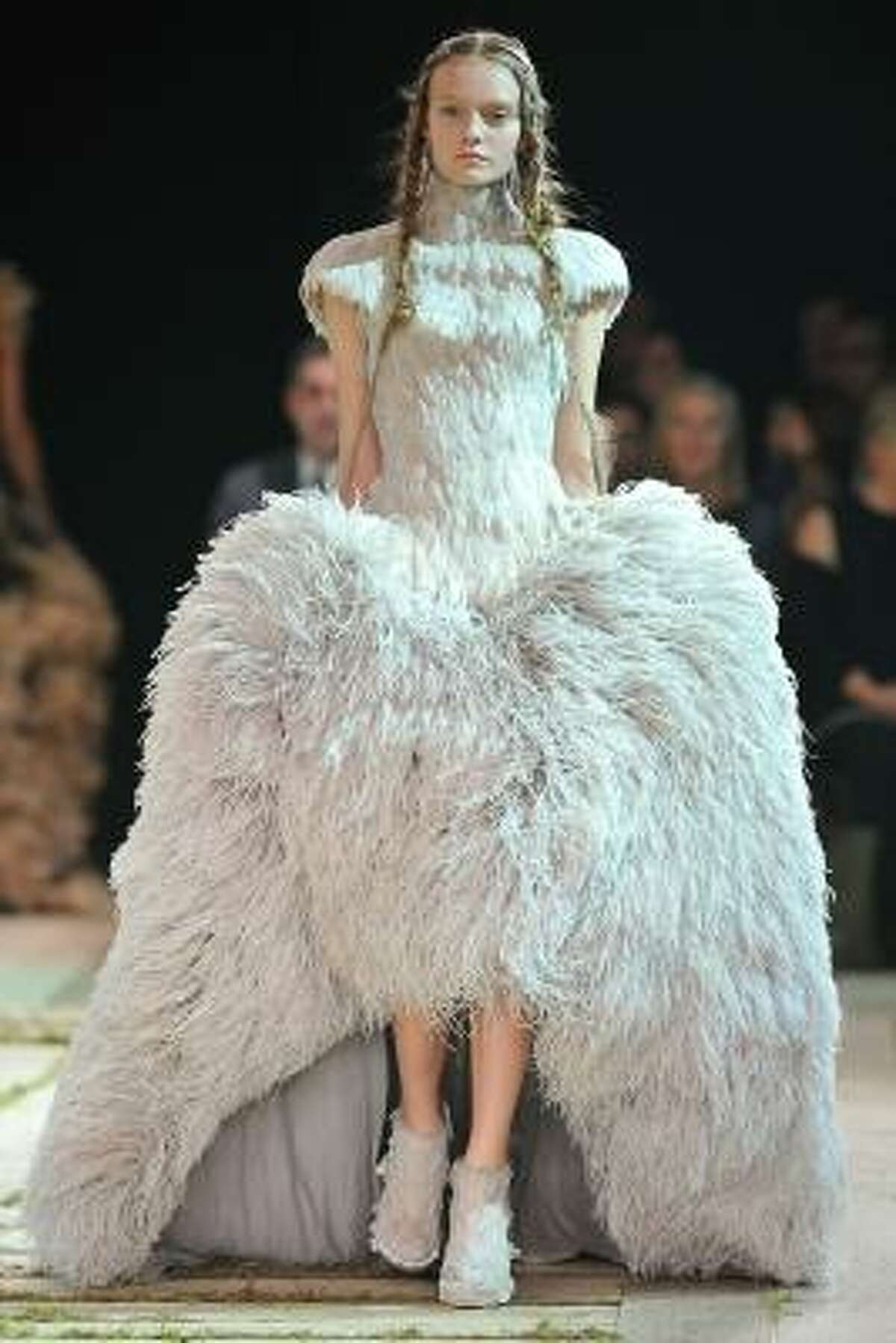 This angelic feathered gown is Alexander McQueen true style: majestic, dramatic and over-the-top.