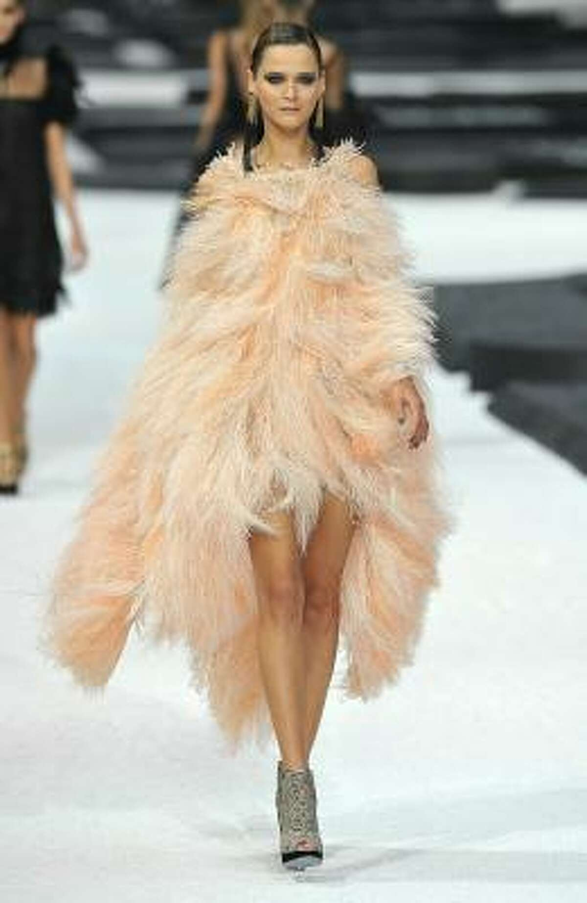Soft, blush-colored feather dress adds a romantic pop to a dark Chanel collection.
