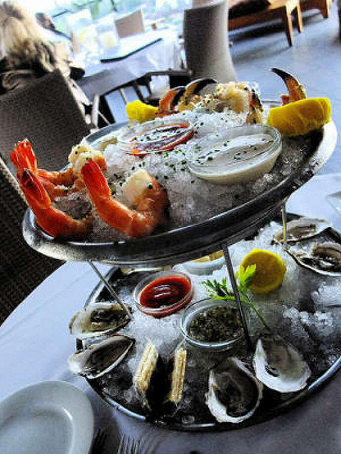 The market-priced, build-your-own shellfish tower at Eddie V's Prime Seafood in west Houston's City Centre.  Colossal Gulf shrimp; Jonah crab claws; Wellfleet, Island Creek, Tatamagouche and Damariscotta Bay Wawenauk oysters on the half shell.. Photo: Alison Cook, Chronicle