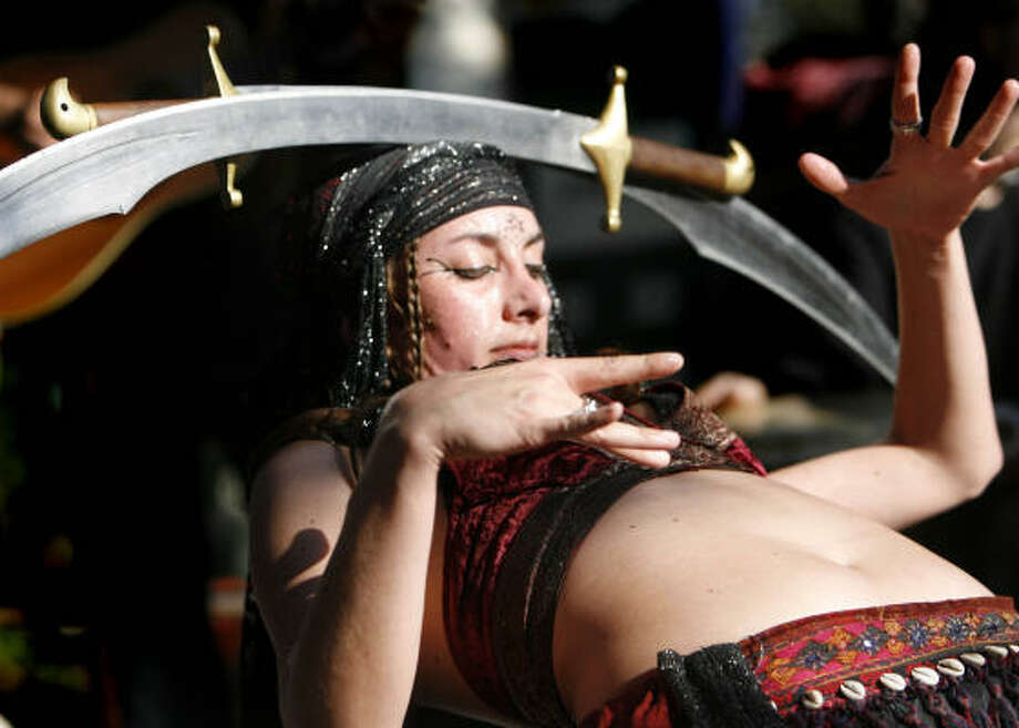 Roxanne Bruscha of Clarkstone, Michigan performs a Greek sword dance.  Photo: Sharon Steinmann, Houston Chronicle
