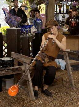 Glass blower, Jody Bove, begins a new piece at the Texas Renaissance Festival. Photo: Brett Coomer, Texas Renaissance Festival