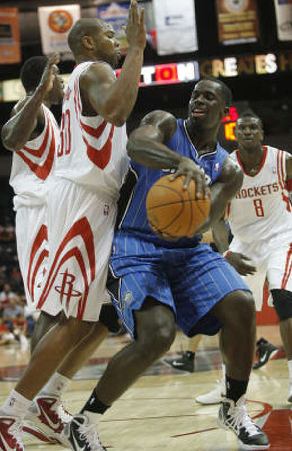 Orlando Magic forward Brandon Bass attempts to pass around Rockets forward Alexander Johnson during the fourth quarter. Photo: Delcia Lopez, AP