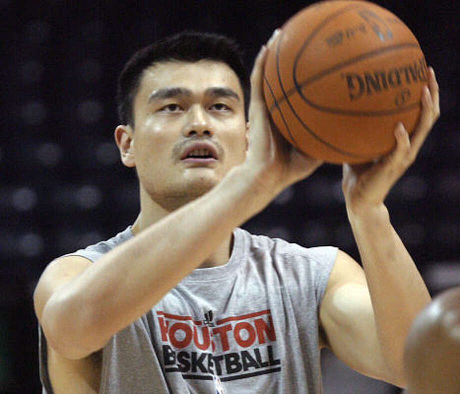 Yao Ming warms up prior to the Rockets' preseason opener against the Orlando Magic. Photo: Delcia Lopez, AP