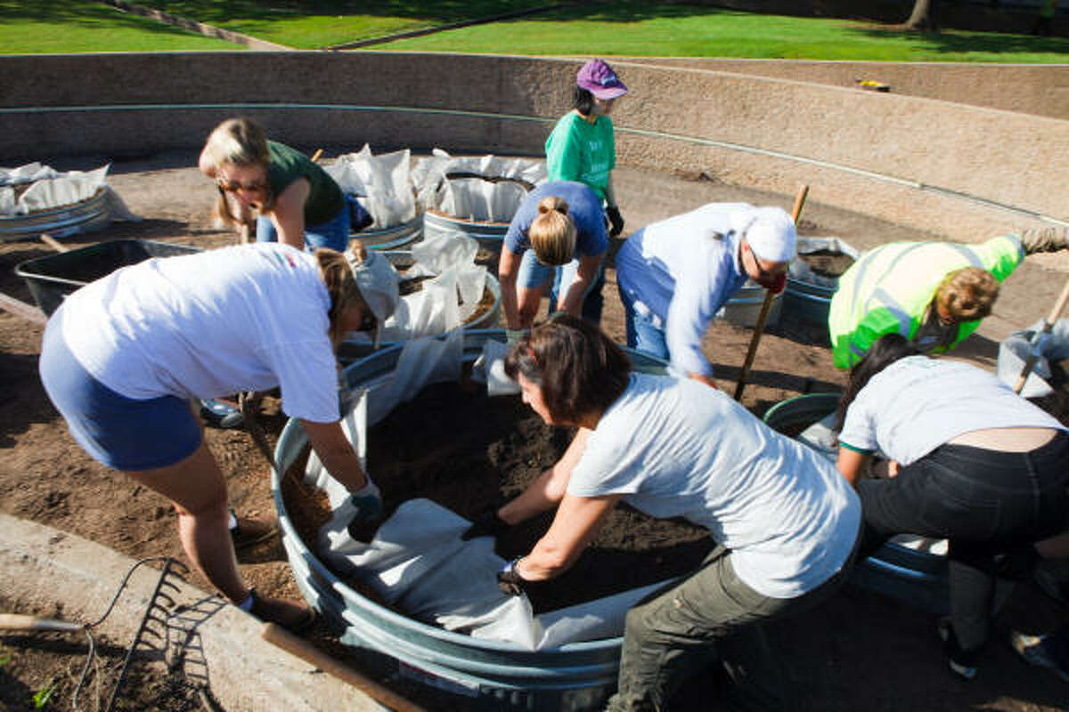 Volunteers help to lay the ground work for the new City Hall Victory Garden.