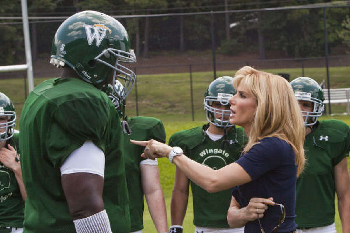 Sandra Bullock stars with Quinton Aaron in football heartwarmer The Blind Side. Take a look at other memorable sports movies from the past.
