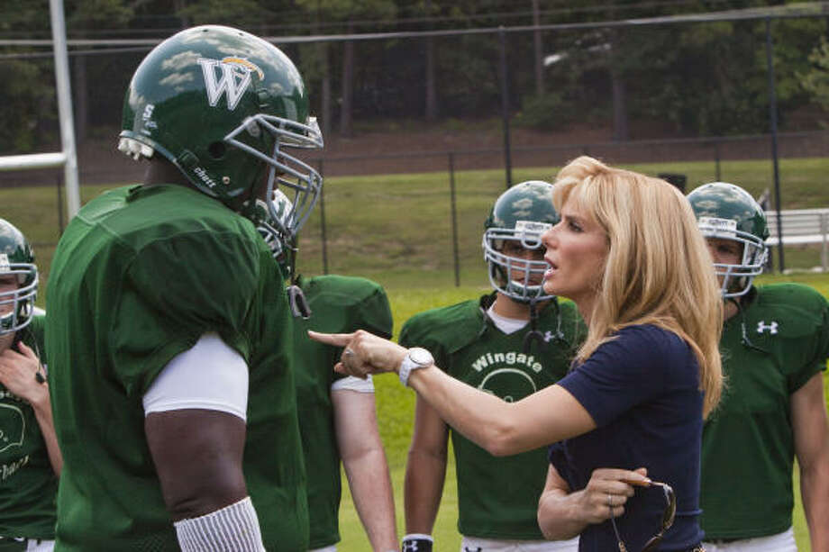 Sandra Bullock stars with Quinton Aaron in football heartwarmer The Blind Side. Take a look at other memorable sports movies from the past. Photo: Ralph Nelson