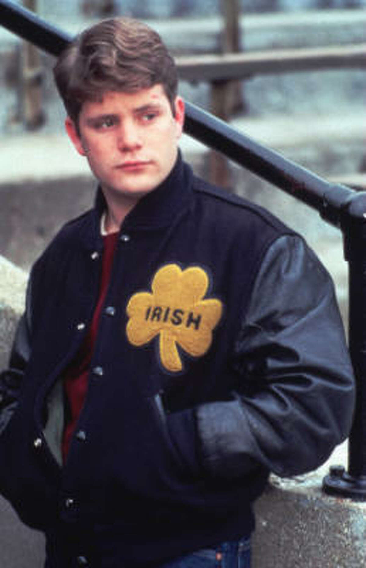 Rudy (1993) is about a boy that overcame the odds to play football at Notre Dame.