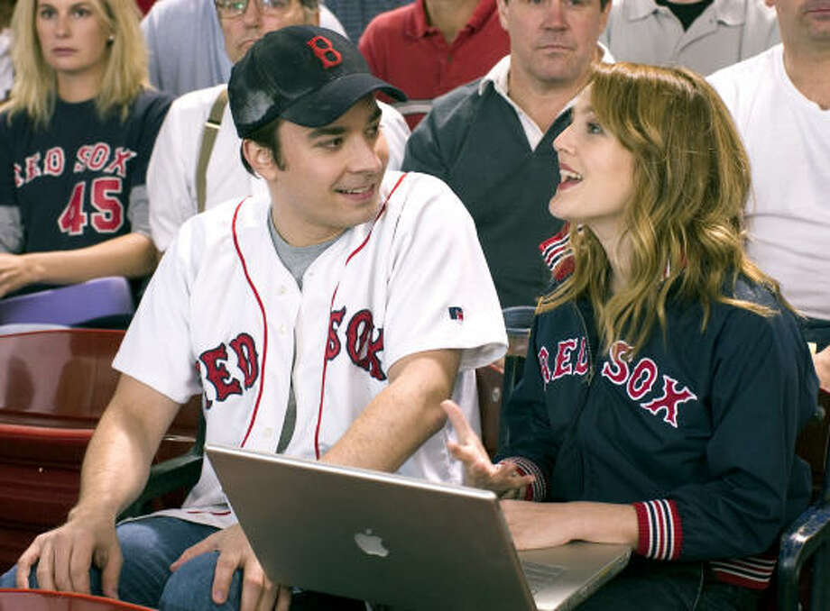 "Drew Barrymore runs (and falls) around on the field at Fenway in ""Fever Pitch."" Yeah, not happening. Photo: DARREN MICHAELS, AP"