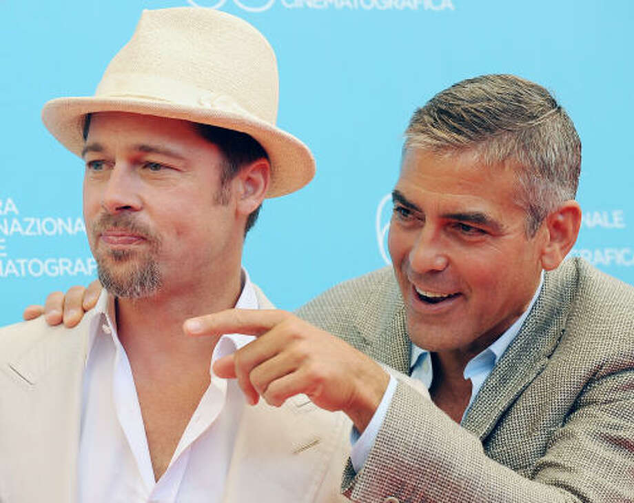 Brad Pitt and George ClooneySexiest men alive bros Photo: ALBERTO PIZZOLI, AFP/Getty Images