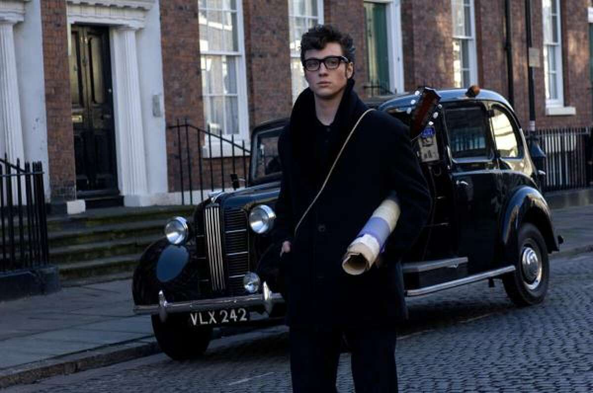 Aaron Johnson (Kick-Ass) portrays a young John Lennon in a scene from the film Nowhere Boy, a biopic about Lennon's life. The film opens in select cities of the U.S. on Oct. 8.
