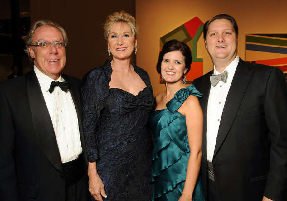 From left: Chairs Mike and Carol Linn with Heather and Chris Enright at the Museum of Fine Arts Houston 's 2010 Grand Gala Ball. Photo: Dave Rossman, For The Chronicle