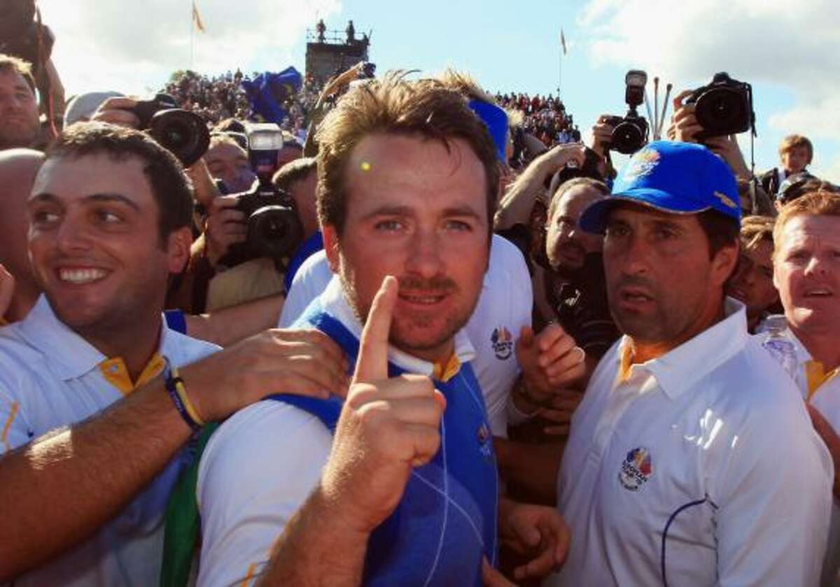 Oct. 4 Graeme McDowell of Europe celebrates his win that clinched the cup for Europe on Monday.