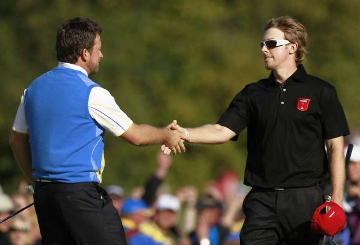 Europe's Graeme McDowell, left, is congratulated by Hunter Mahan of the U.S. after Europe won the 2010 Ryder Cup.