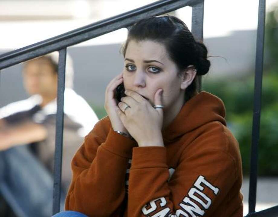 UT student Morgan Hawthorne waits outside after police evacuated Jester Center to conduct a search. Photo: Larry Kolvoord, AP