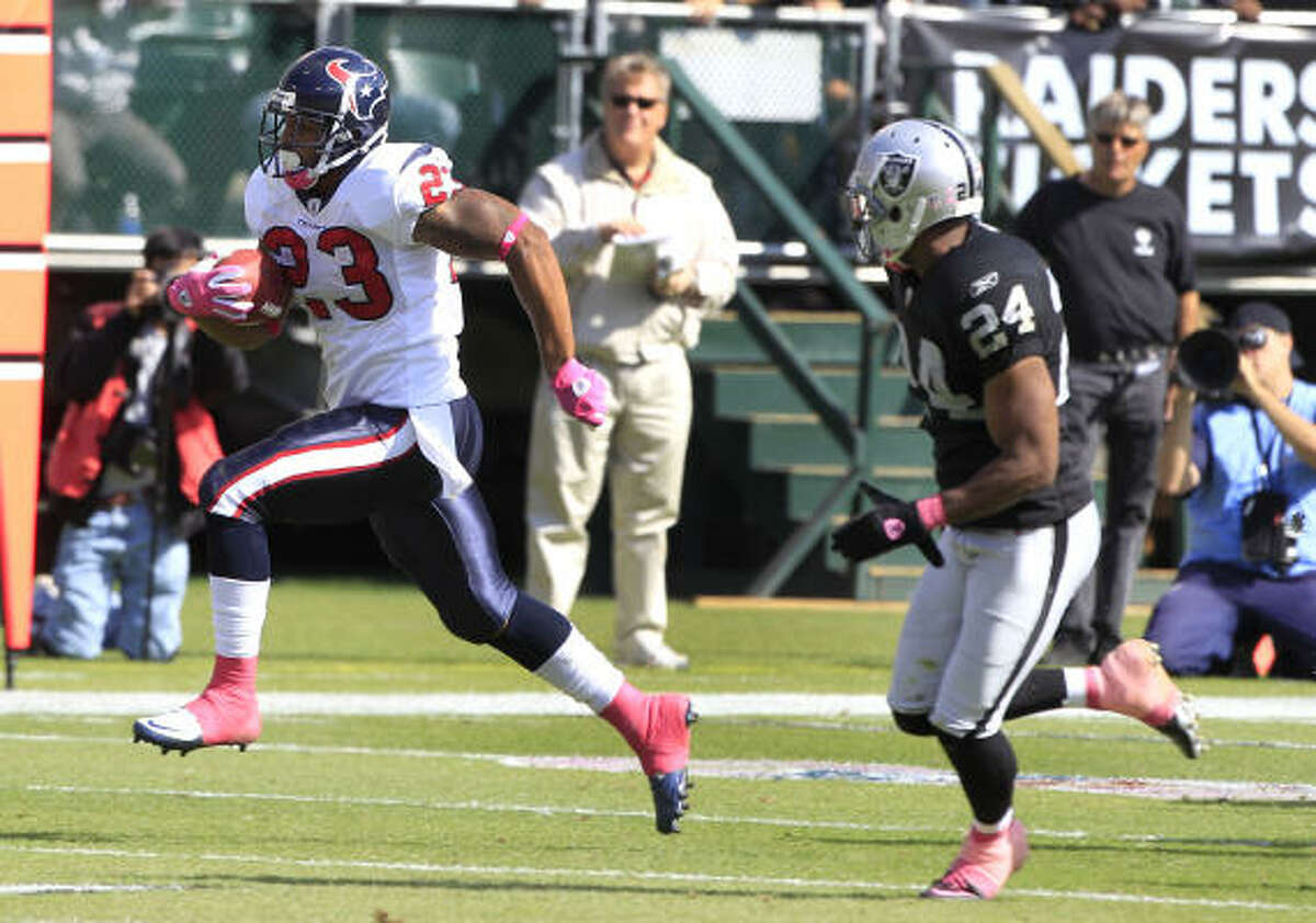 Texans running back Arian Foster, left, breaks away from Raiders safety Michael Huff on a 74-yard touchdown run during the third quarter. Foster rushed for a game-high 131 yards and a touchdown and also caught three passes for 56 yards and a score in the Texans' 31-24 victory.