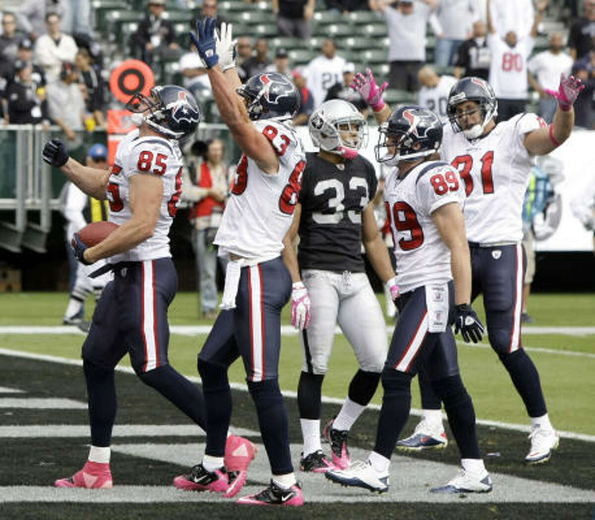 Texans tight end Joel Dreessen (85) celebrates his 11-yard touchdown reception with teammates Kevin Walter (83), David Anderson (89) and Owen Daniels (81) during the first quarter.