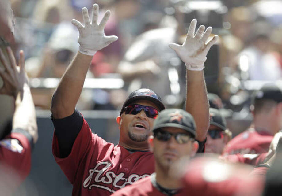 Oct. 3: Astros 4, Cubs 0 Carlos Lee celebrates in the dugout after hitting a home run in the third inning of Sunday's season finale at Minute Maid Park. Photo: Karen Warren, Chronicle