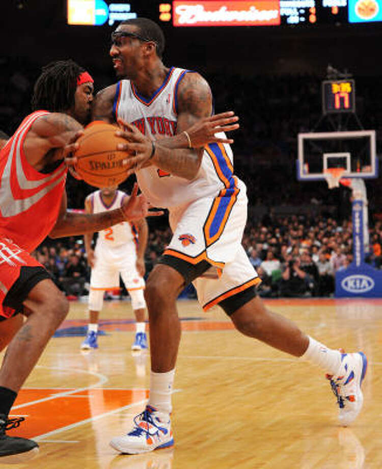 Rockets forward Jordan Hill defends Knicks forward Amar'e Stoudemire during Sunday night's win. Photo: Christopher Pasatieri, MCT