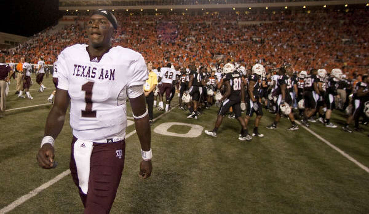 Sept. 30: Oklahoma State 38, Texas A&M 35 Texas A&M quarterback Jerrod Johnson walks to the locker room after losing to Oklahoma State on Thursday night at Boone Pickens Stadium in Stillwater, Okla. Johnson threw five touchdown passes, but also committed five turnovers, including an interception that set up Oklahoma State's game-winning field goal.