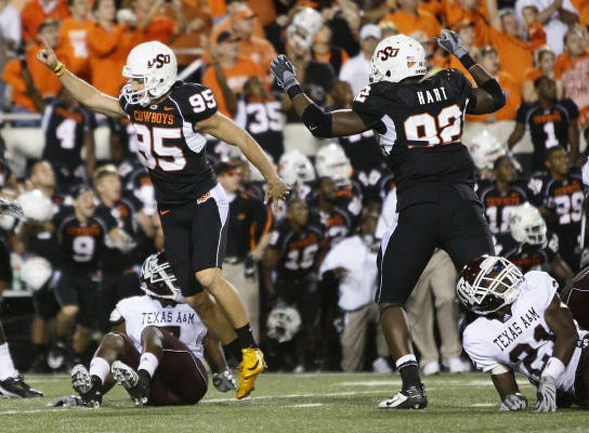 Oklahoma State kicker Dan Bailey (95) celebrates after making the game-winning field goal in the fourth quarter.
